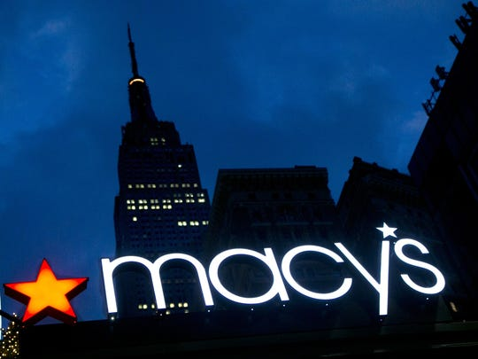 The Macy's logo is illuminated on the front of the