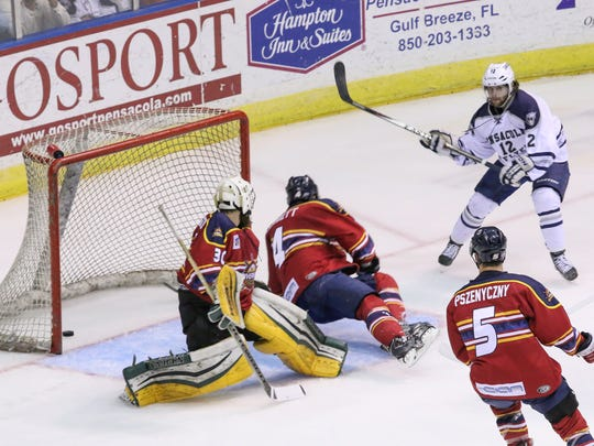 GANNETT FILE IMAGE: Peoria goalie David Jacobson and teammate Mark Corbett (4) can't stop Pensacola's Brandon Zurn (12) from getting a goal during Game 3 of the SPHL championships in 2016. The Wicomico County is looking to bring a team from that league to play in Salisbury.