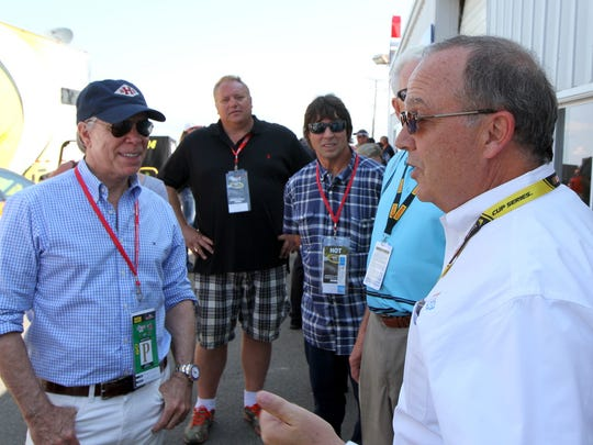 Elmira native Tommy Hilfiger (left) talks with Chemung native Brett Bodine before a Cup race at Watkins Glen International.