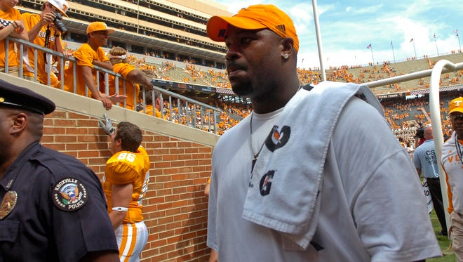 Former University of Tennessee football player Albert Haynesworth follows players off the field after their 63-7 win over Western Kentucky on Saturday September 5, 2009.