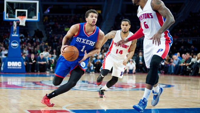 The 76ers' Michael Carter-Williams drives to the basket against the Pistons' Josh Smith during the second quarter Saturday at The Palace of Auburn Hills.