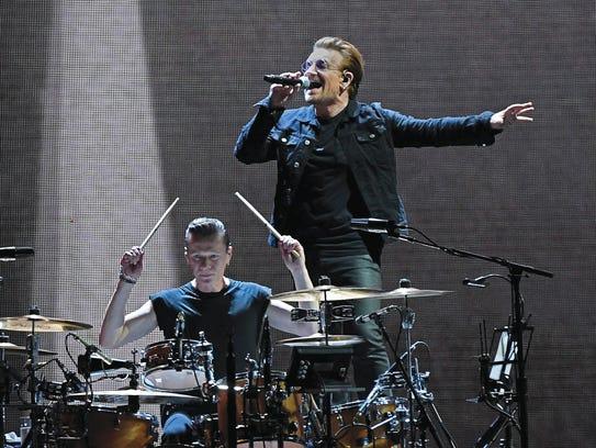 Drummer Larry Mullen Jr. (left) and singer Bono of