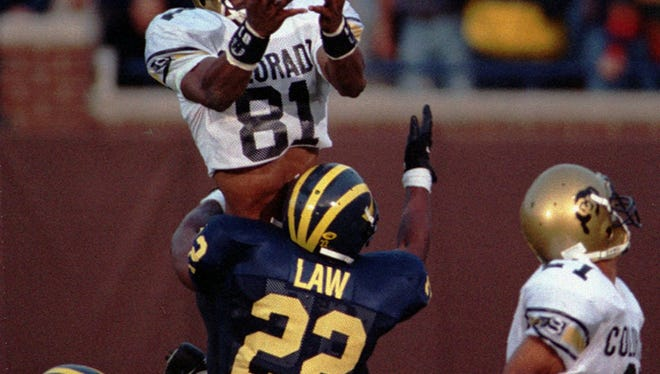 Colorado's Michael Westbrook reaches over Michigan's Ty Law to make the game-winning catch with no time left in Colorado's 27-26 win in Ann Arbor on Sept. 24, 1994.