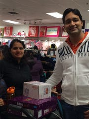 Vaibhav Sharma, right, shops with his family at JCPenney