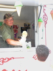 Carl Rader of Rader's Old Fashioned Ice Cream serves up a cone during a 2015 event in New Washington. This Friday, Rader's will be at the Crawford County Fairgrounds for the first Food Truck Friday event.