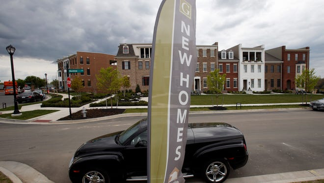Advertising signs point out completed new homes, homes under construction as well as lots for new homes in Glen Allen, Va. On Wednesday, May 23, the Commerce Department reports on sales of new homes in April.