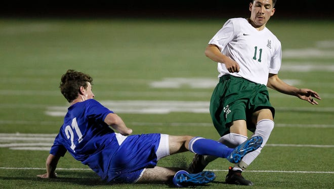 Los Altos' Luke Wagness slides in front of Alisal's Jose Luis Trejo to steal the ball during an CCS Open Division Playoff soccer game between the Alisal Trojans and the Los Altos Eagles at Alisal High School on Saturday, February 24, 2018 in Salinas, Calif. Vernon McKnight/for The Californian