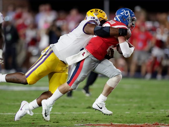 LSU defensive end Frank Herron (97) sacks Mississippi