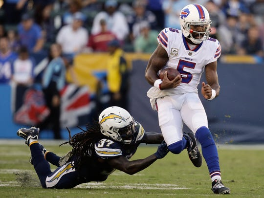 Buffalo Bills quarterback Tyrod Taylor runs against the Los Angeles Chargers during the second half of an NFL football game Sunday, Nov. 19, 2017, in Carson, Calif. (AP Photo/Jae C. Hong)