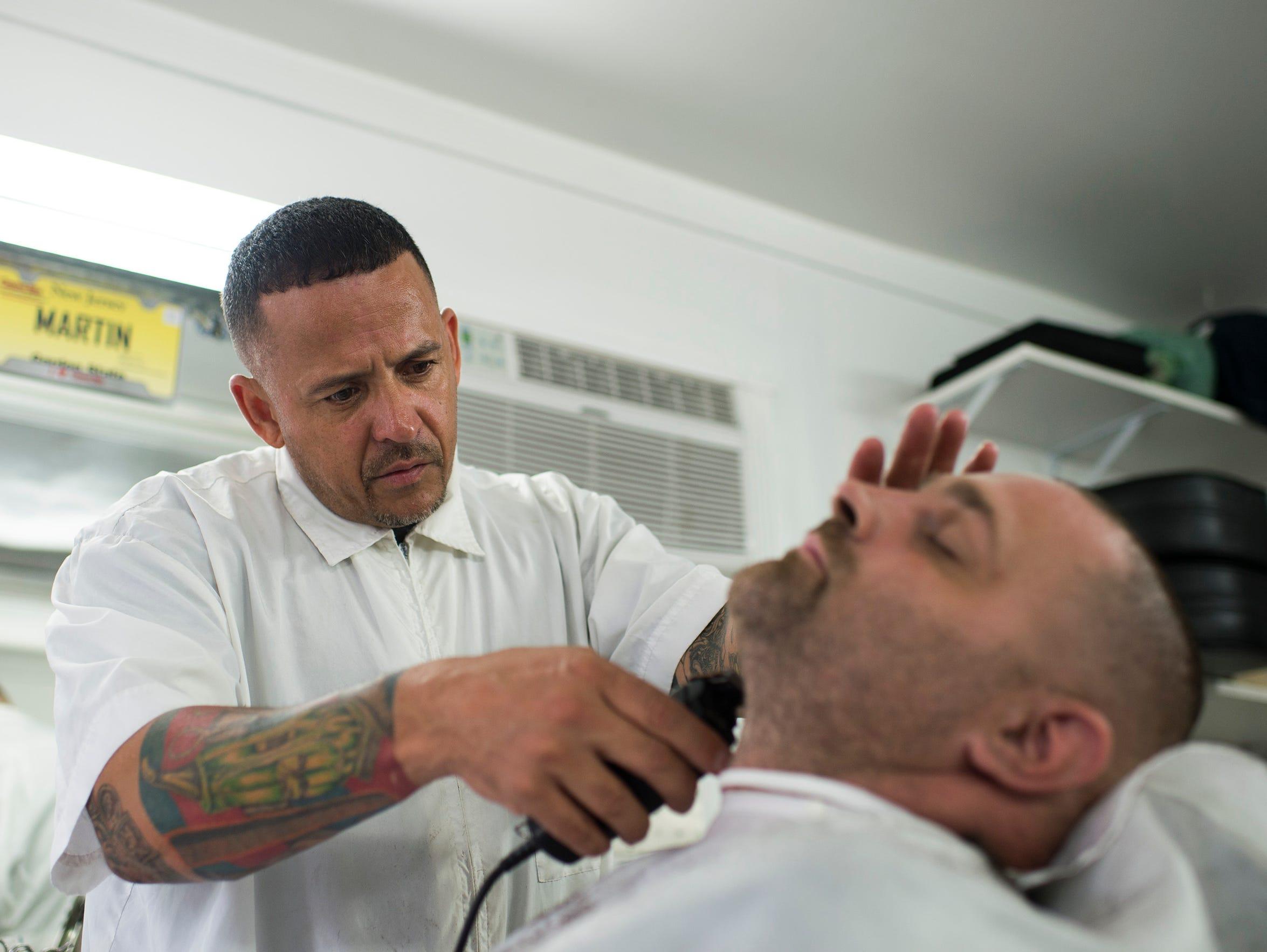 Martin Ortiz, 47, left, owner of Martin's Da Shop in