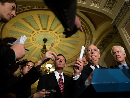Senate Majority Leader Mitch McConnell speaks to reporters