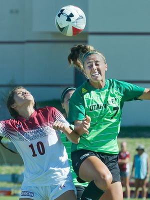 New Mexico State's Aileen Galicia (10) and Utah Valley's Lexi Felis fight to head the ball during the first half of play Sunday morning at the NMSU Soccer Complex.