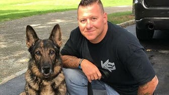 Dome, a longtime member of the Mahwah Police Department K-9 Unit, with Officer Robert Rapp.