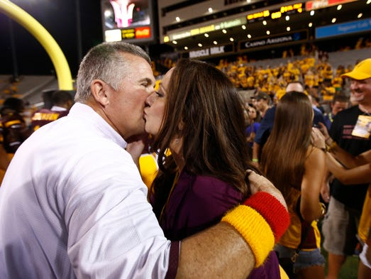 ASU head coach Todd Graham gets a kiss from his wife