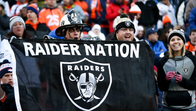 Oakland Raiders fans cheer as their team leads the Denver Broncos at Sports Authority Field at Mile High on December 13, 2015 in Denver, Colorado.