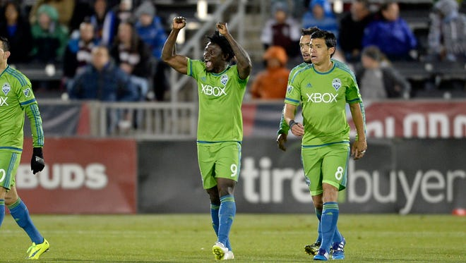 Seattle Sounders FC forward Obafemi Martins (9) celebrates his goal along side midfielder Gonzalo Pineda (8) against the Colorado Rapids in the second half of the match at Dicks Sporting Goods Park.