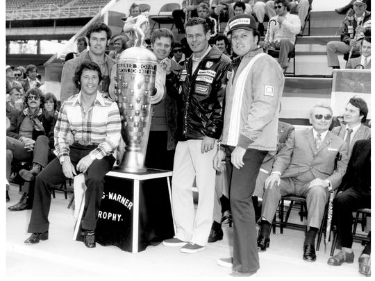 Trophy hair: Mario Andretti, Al Unser, Mark Donohue, Bobby Unser and A.J. Foyt pose with the Borg-Warner in '73. Only Foyt wore a hat. Only Foyt needed to.