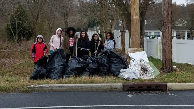 "Members of the Students Helping Animals, Plants and the Environment (S.H.A.P.E.) Club at Vineland High School participated in Cumberland County Improvement Authority's ""Trash Hunt."" The student volunteers picked up trash on a section of Brewster Road."