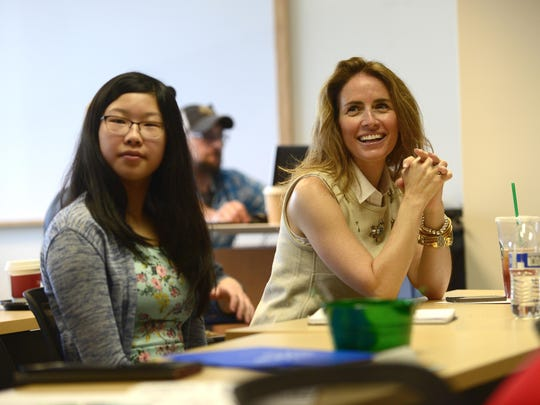 Alexis Glick (right) , CEO, GENYOUth, speaks to students during a collaboration between Workforce Software and GENYOUth.