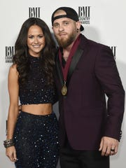 Brantley Gilbert and wife, Amber Cochran, walk the