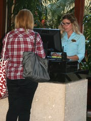 Chrissy Tross assists guests at front desk of Hyatt Regency Coconut Point  Resort & Spa in Bonita Springs on Thursday.