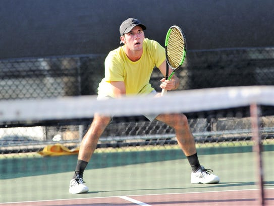 Wylie's Lane Adkins waits to return a serve during