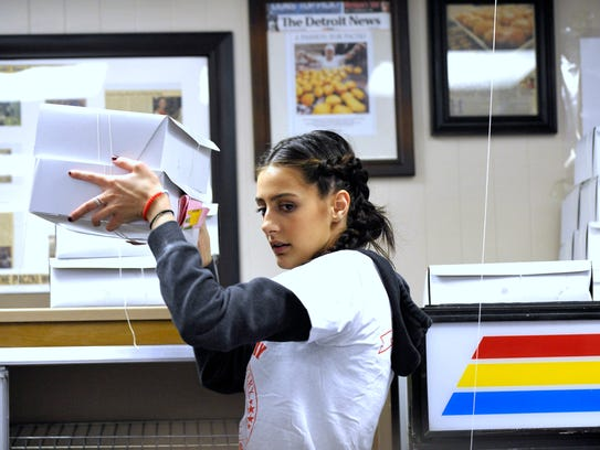 New Palace Bakery employee Elizabeth Cotora, 19, of