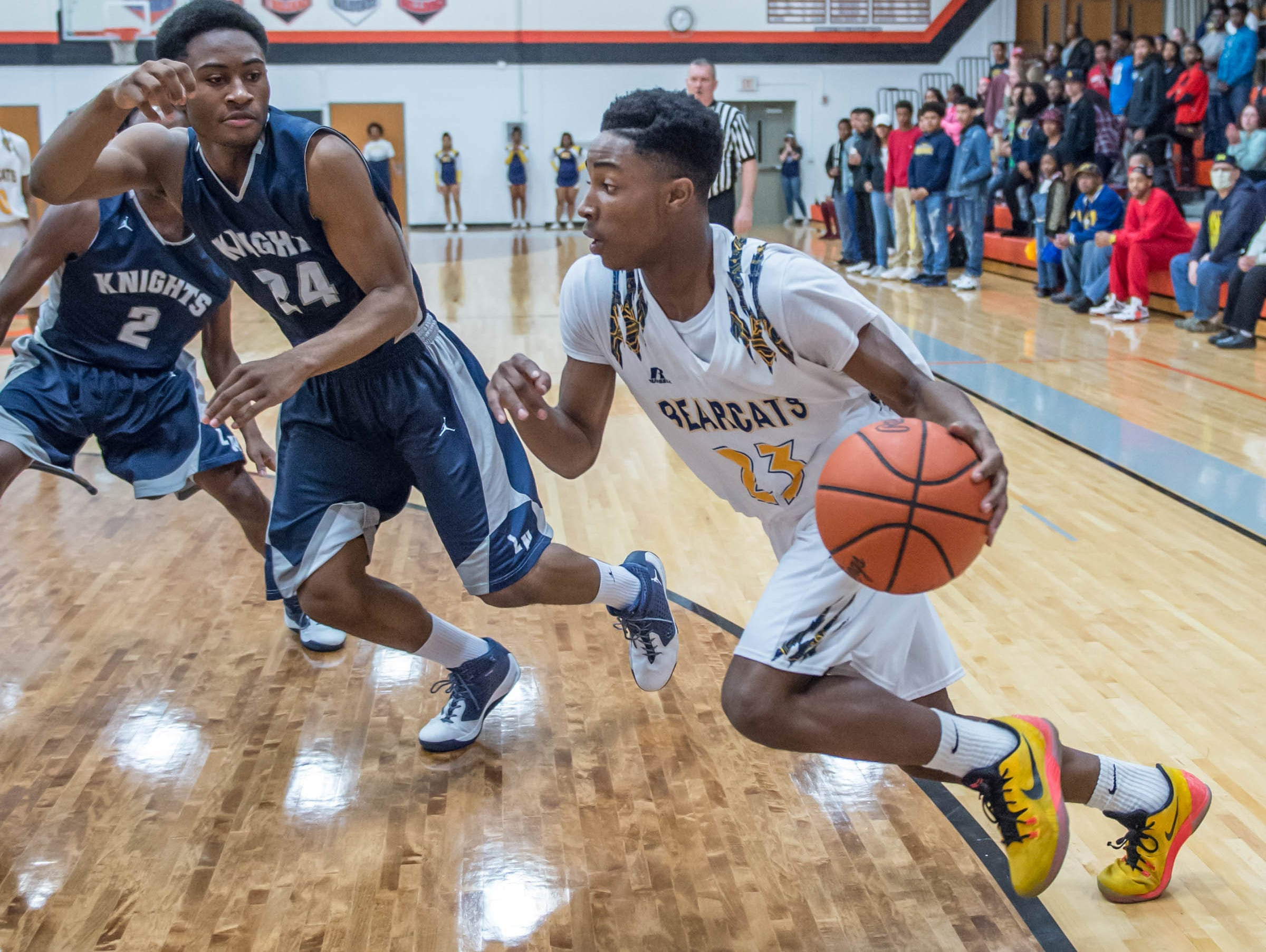 Battle Creek Central's Dontell Hardy (23) drives to the hoop against Loy Norrix Friday night.