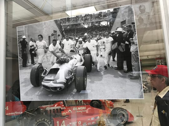 A display showing race car legend A.J. Foyt in a photo