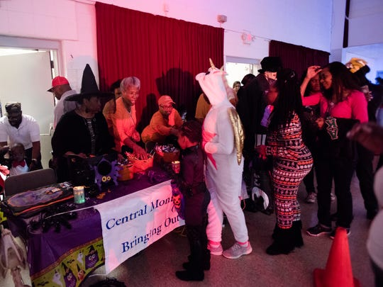 Businesses hand out candy to children during the Montgomery County Sheriff's Office Annual Halloween Spooktacular on Tuesday, Oct. 31, 2017, in Montgomery, Ala.