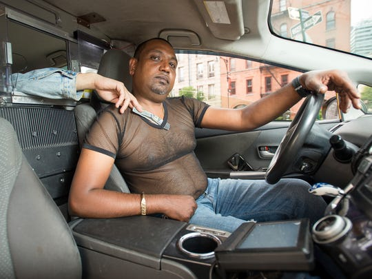 In this photo provided by Shannon Kirkman, taxi driver Terry Samlall poses for the NYC Taxi Drivers calendar in New York.