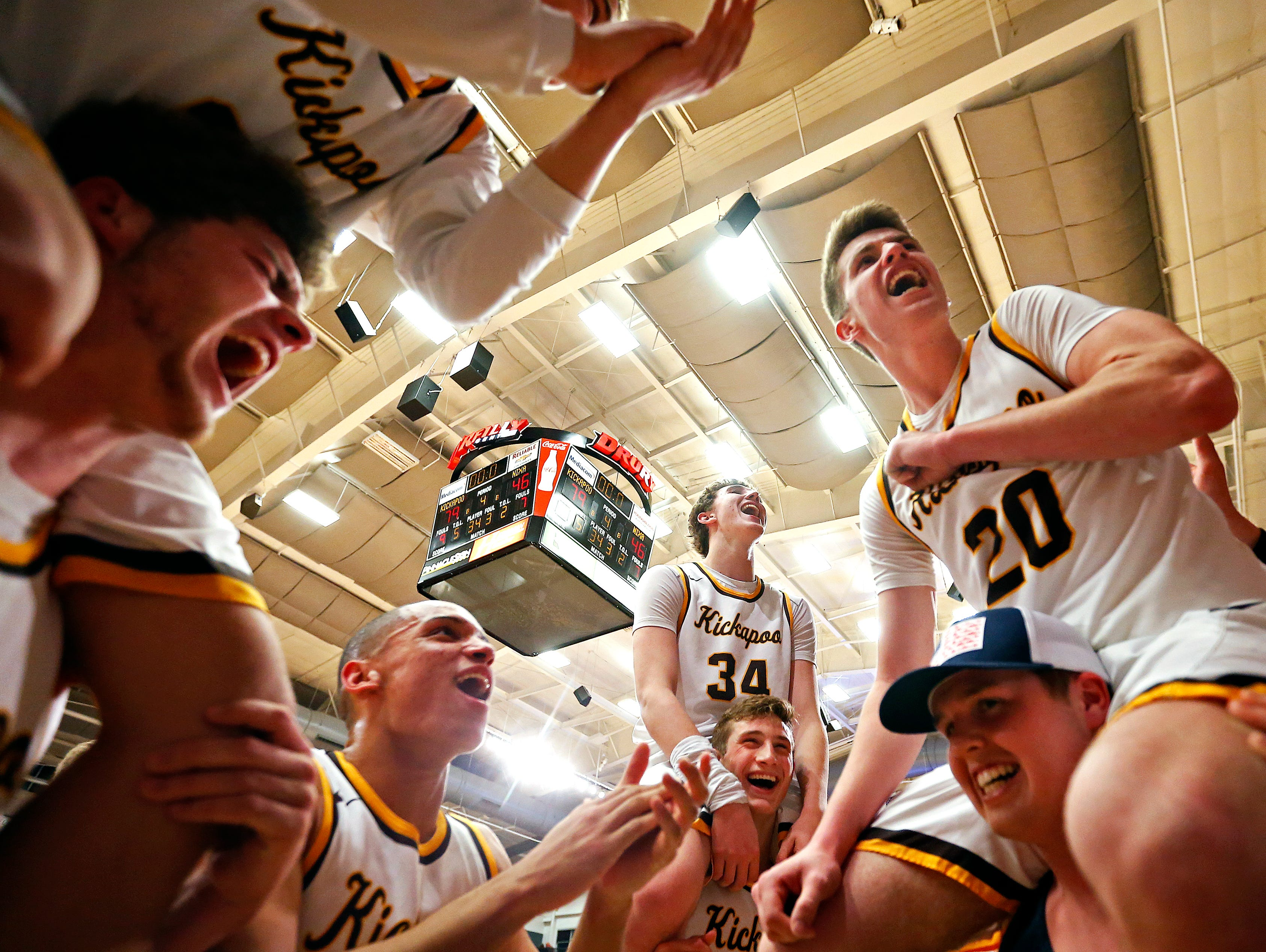 Kickapoo Chiefs players celebrate after the end of the MSHSAA Class 5 sectional playoff game between the Kickapoo High School Chiefs and the Nixa High School Eagles at the O'Reilly Family Event Center in Springfield, Mo. on March 8, 2017. The Kickapoo Chiefs won the game 79-46.