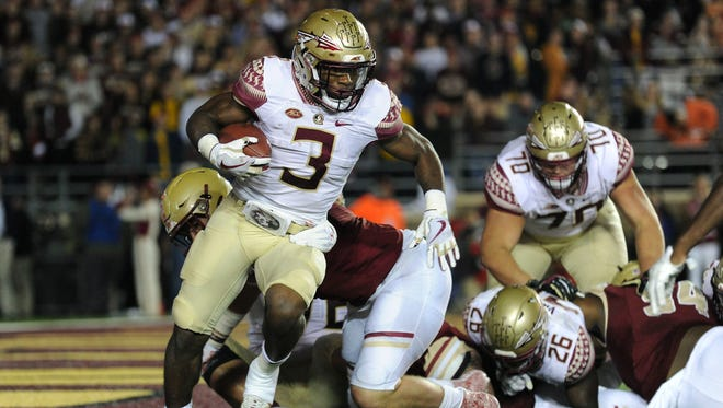 Florida State freshman running back Cam Akers (3) struggles to gain positive yardage as a result of the Seminoles stumbling offensive line during a 35-3 loss to  to Boston College on Friday night at Alumni Stadium.