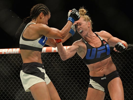 Holly Holm (red) fights Marion Reneau (blue) during