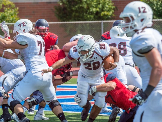 Gannon's Tyler Johnson is brought down by Shippensburg's defense during a game Saturday. The Golden Knights took a 23-20 victory.