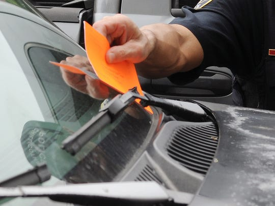 After months in the works, it's likely that parking tickets will begin appearing on motorists' windshields within the next few weeks.