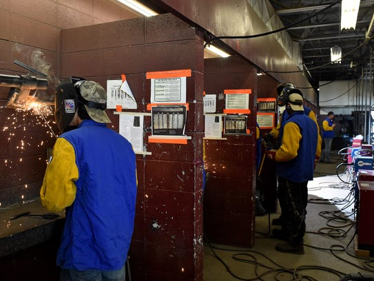 First-year students practice welding Monday, Oct. 23,