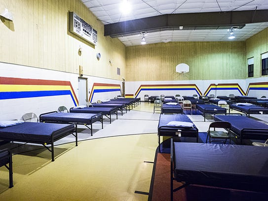 Beds are set up for homeless people looking for a warm place to sleep Wednesday in the Fond du Lac Salvation Army gym. People must be in by 9pm and are not allowed to leave until 8am the next morning. Doug Raflik/USA TODAY NETWORK-Wisconsin