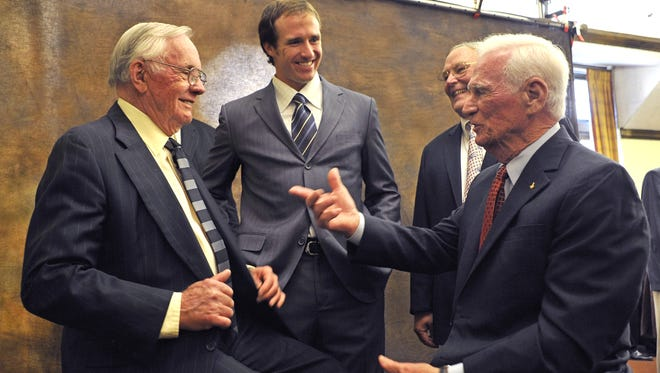 Gene Cernan, right, talks with Neil Armstrong, from left, former Purdue quarterback Drew Brees, and astronaut Jerry Ross in this 2011 photo, taken during National Football Foundation Honors Dinner at Purdue. Armstrong and Cernan were the first and most recent men to walk on the moon. Cernan died Monday at age 82.