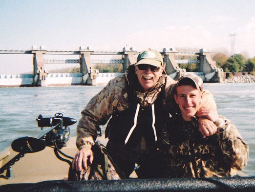 Abdul-Rahman Kassig fishing with his father, Ed Kassig, near the Cannelton Dam on the Ohio River in southern Indiana in 2011.