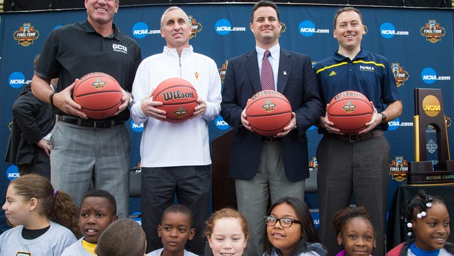 Basketball head coaches (from left) Dan Majerle, GCU, Bobby Hurley, ASU, Sean Miller, Arizona, and Jack Murphy, NAU, pose for photos during the 2017 NCAA Men's Basketball Final Four-Phoenix logo unveiling and announcement of plans for an NCAA Legacy Restorations project at Harmon Park in Phoenix Nov. 10, 2015.
