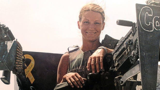 Stephanie Kemplin of Maineville, Ohio, served in the Army in 2003 in Kuwait.
