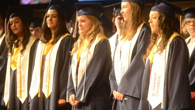 Seniors are recognized at Liberty Common High School's first graduation commencement at Timberline Church in 2013.