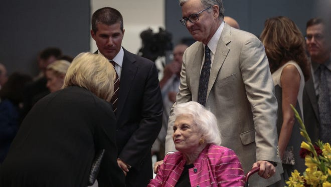 Retired Supreme Court Justice Sandra Day O'Connor greets guests at the law school named for her at Arizona State University on Aug. 15, 2016.