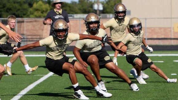 Rider football players run drills Monday, Aug. 14,