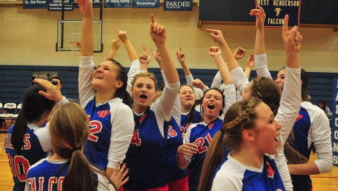 West Henderson volleyball players celebrate after Saturday's playoff win over South Iredell.