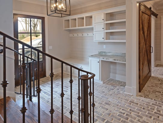 A tile or brick floor in a utility area or mudroom