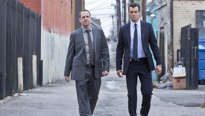 Mismatched detectives Russ Agnew (Dean Winters, left) and Milt Chamberlain (Josh Duhamel) patrol the streets of 'Battle Creek.'