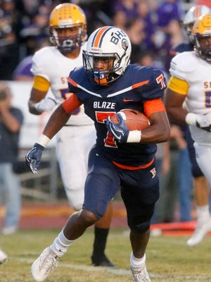 Blackman's Cordel Braxton (7) looks for running room during a game against Smyrna this season.