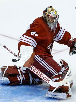 Arizona Coyotes goalie Mike Smith (41) makes a save against the Los Angeles Kings  in their  preseason NHL game Monday, Sept. 22,  2014 in Glendale.